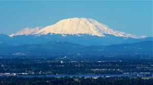 Mt. St. Helens with Mt. Rainer on its left flank.