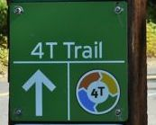 4T signs on the trail are green